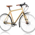 Gold commuter bike on white background