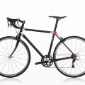Black road bike on white background