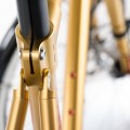 bicycle seat tube detail on gold bike